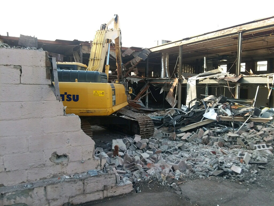 building demolition with machinery